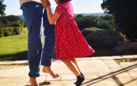 Dad dancing with child.